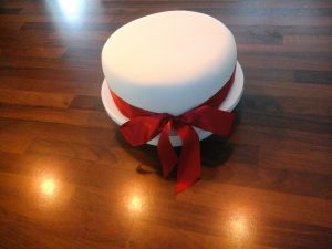 Traditional Cake with Red Ribbon