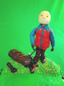 Golf Cake with Golfer. He looks happy with his shot!