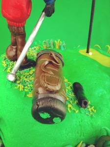 Golf Cake with Golfer and his Golf Bag. Just took a good shot too!
