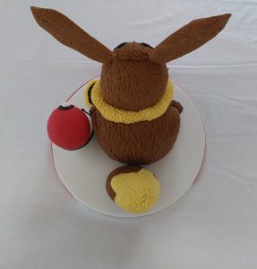 Eevee Cake with Pikachu sitting in a Pokeball Cake Backview